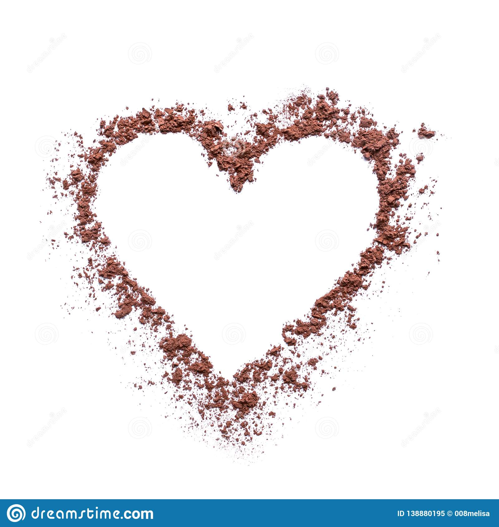 Cocoa powder or coffee in the shape of a heart.