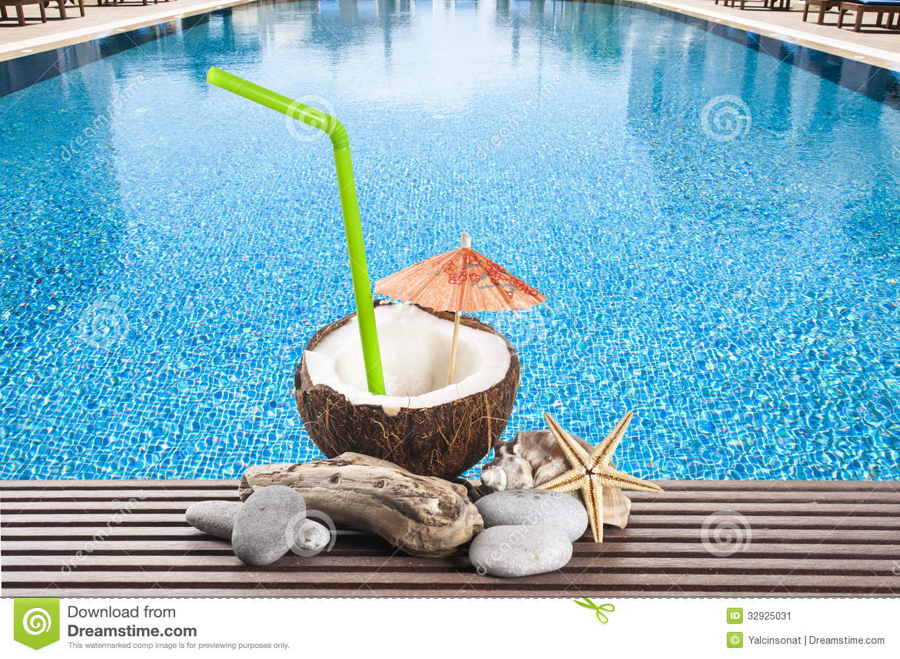 Coconut cocktail with green drinking straw and cocktail umbrella by ...