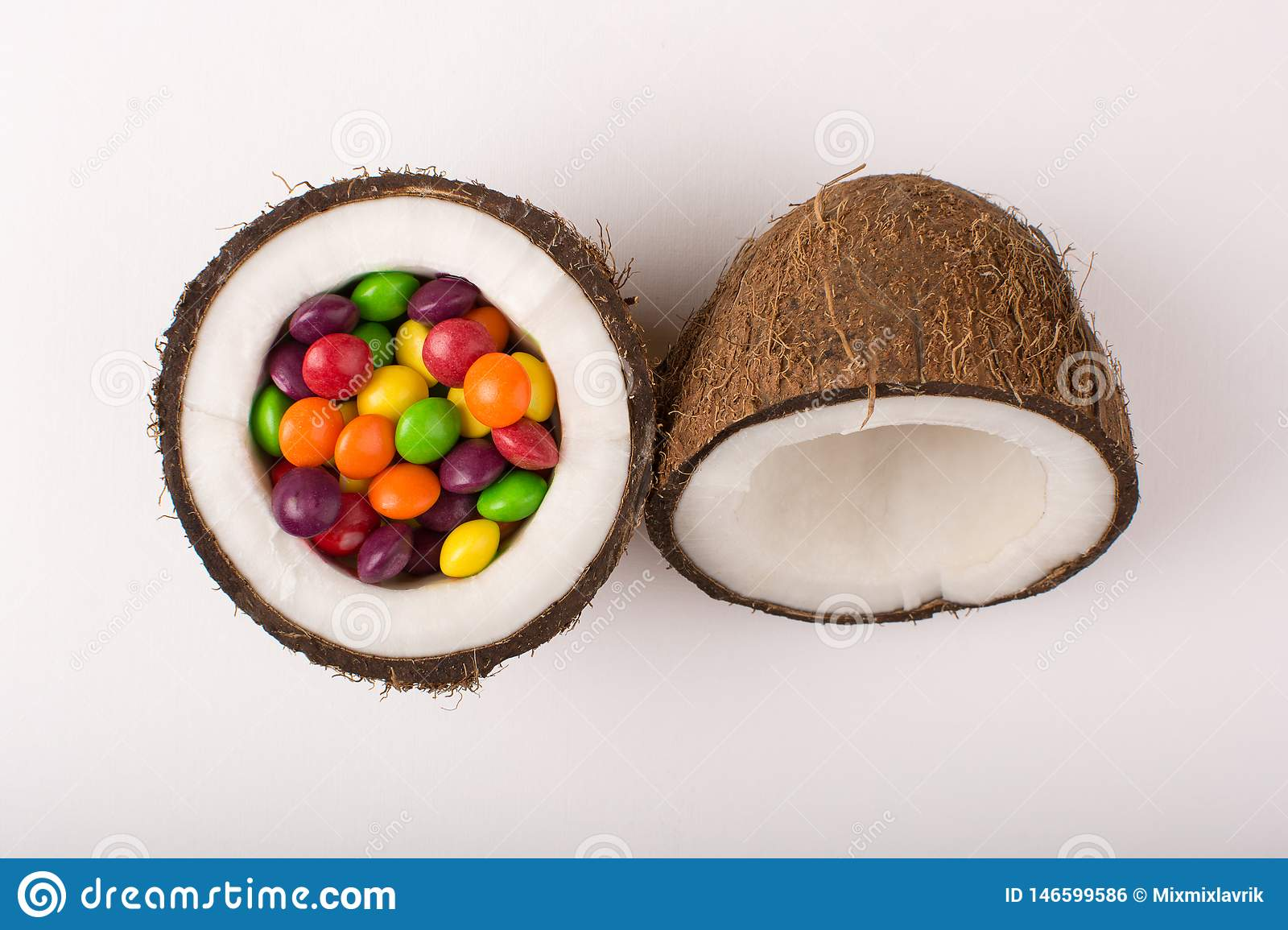 Coconut with colorful candies.