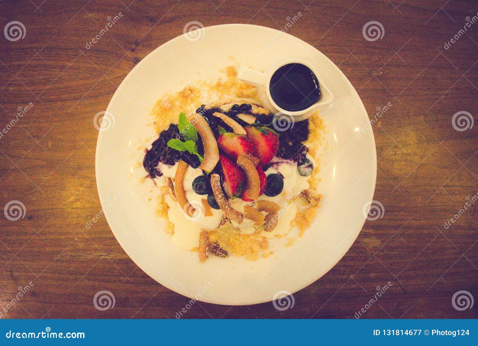 Coconut flour pancakes Blueberry compote, fresh banana whipped greek yoghurt