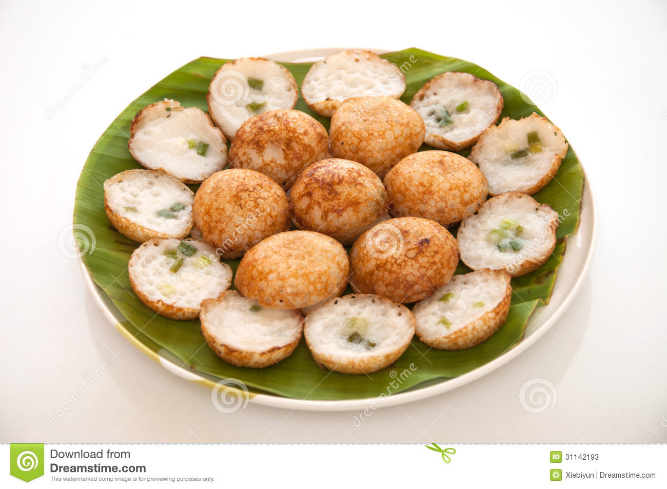 is Thai sweet and savory grilled coconut-rice pancakes using coconut ...