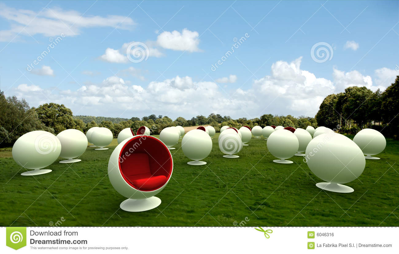 cocoon chairs in a meadow royalty free stock image