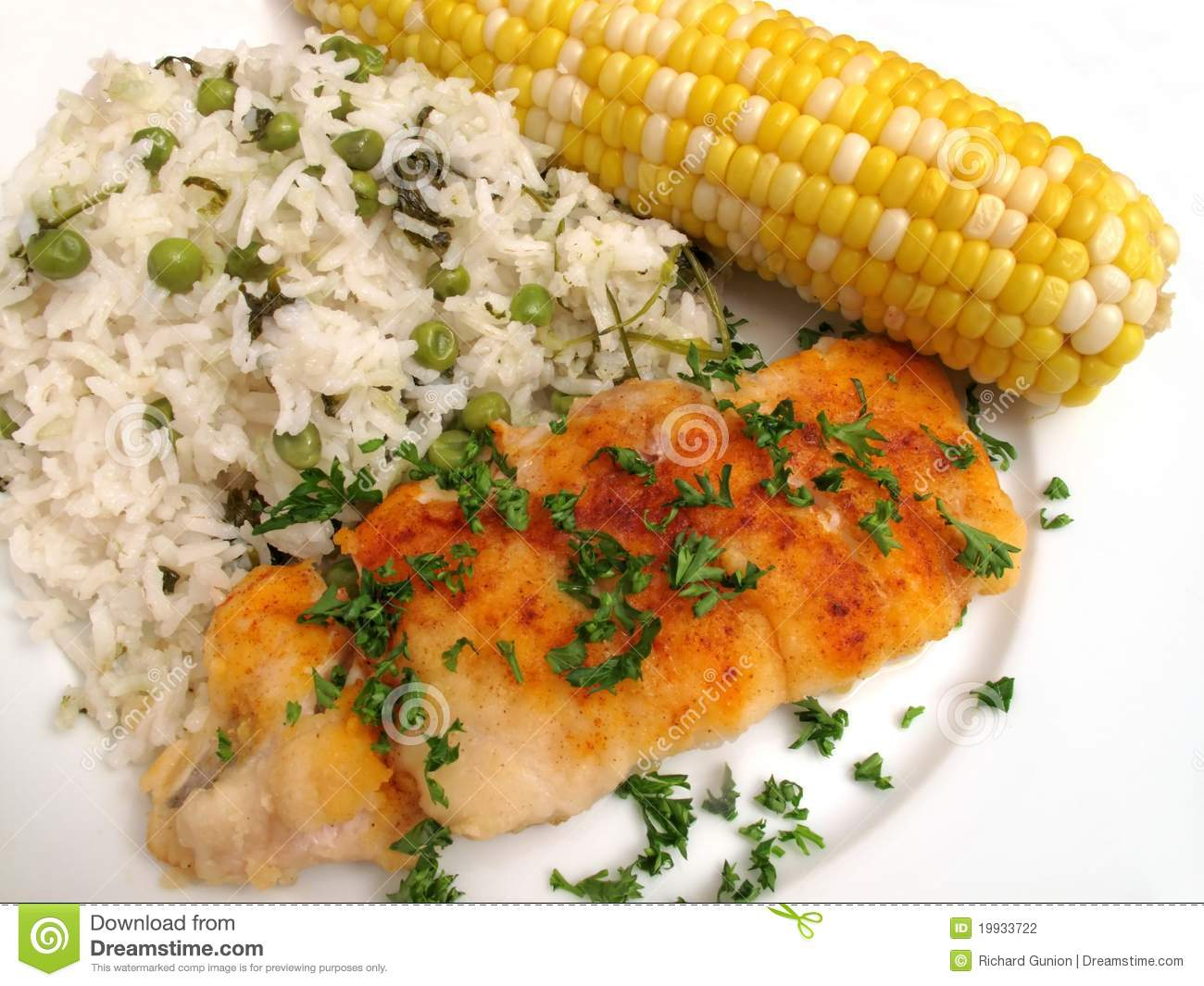 codfish fillet, ear of corn and rice served for dinner. Oven baked cod ...