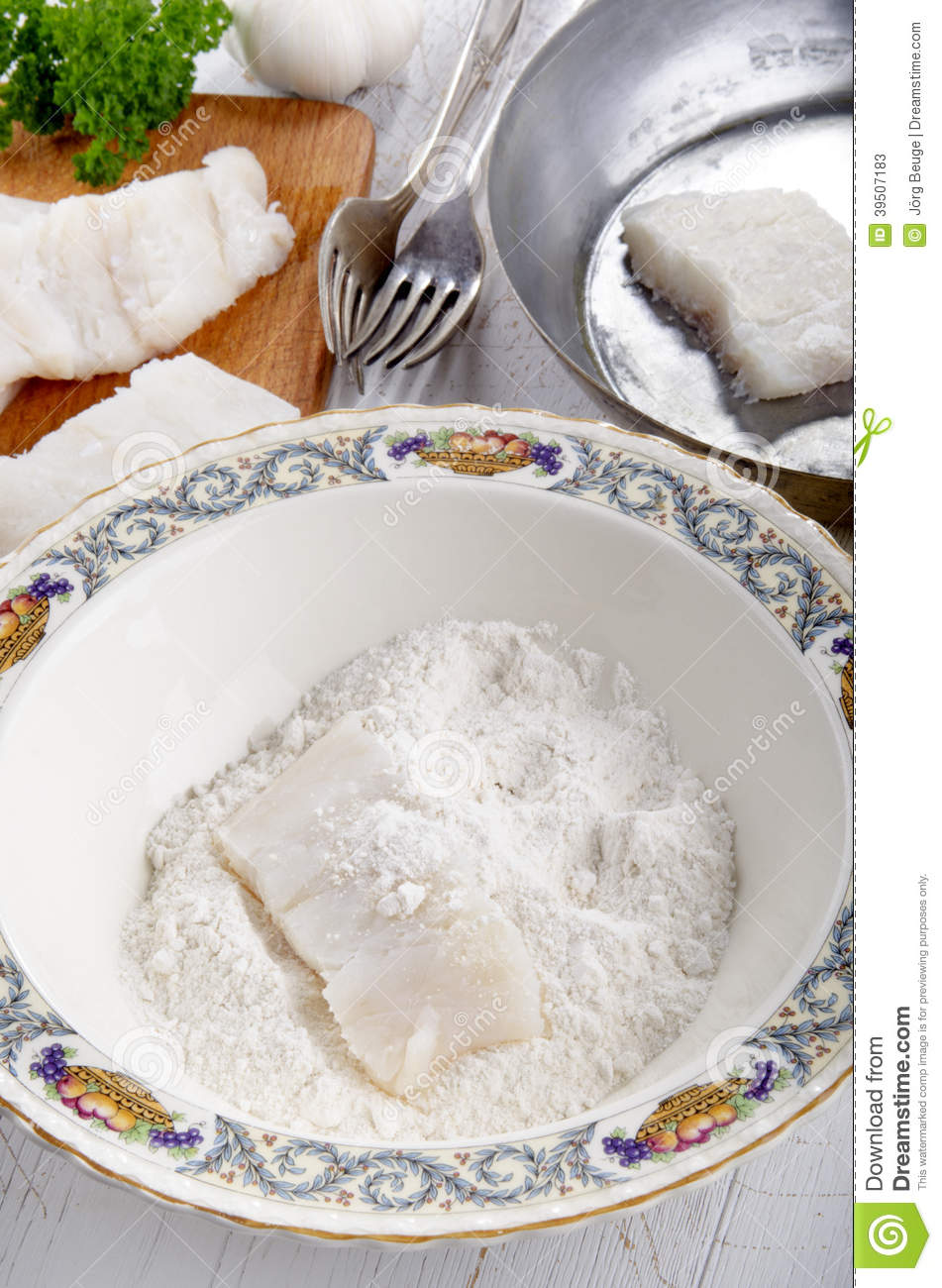 Cod filet in flour placed