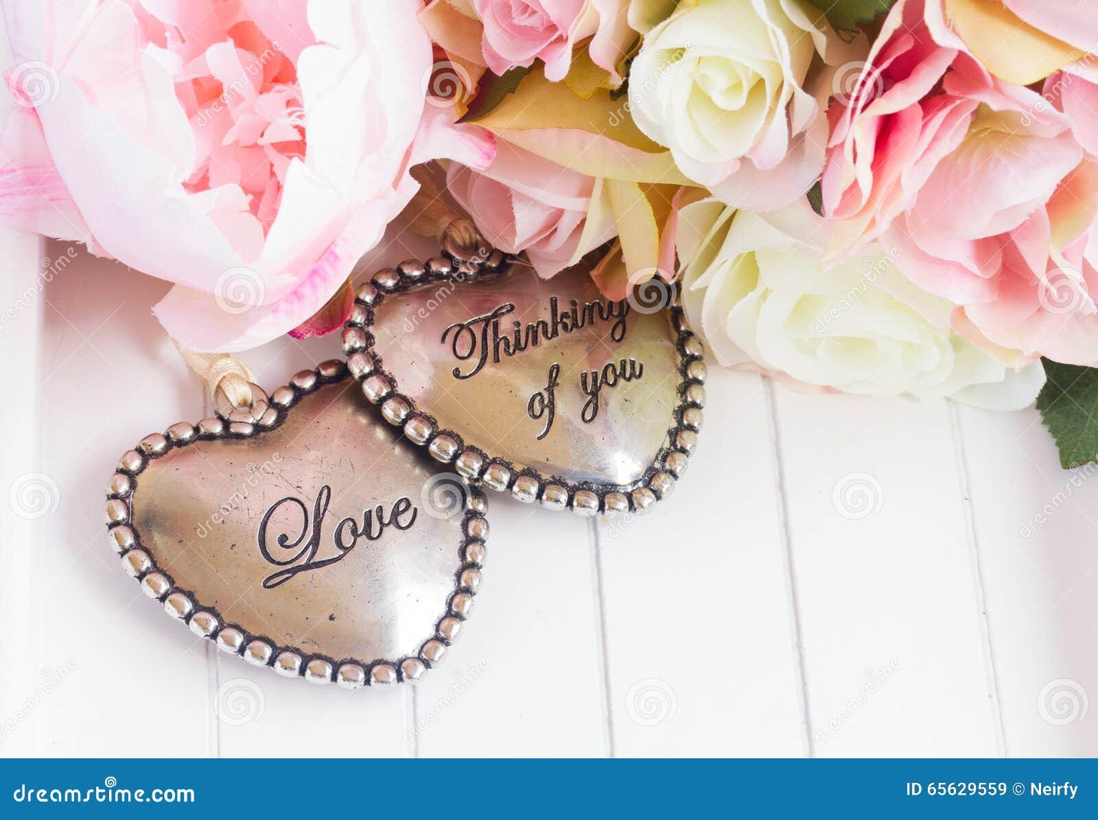 Coeur avec les roses roses