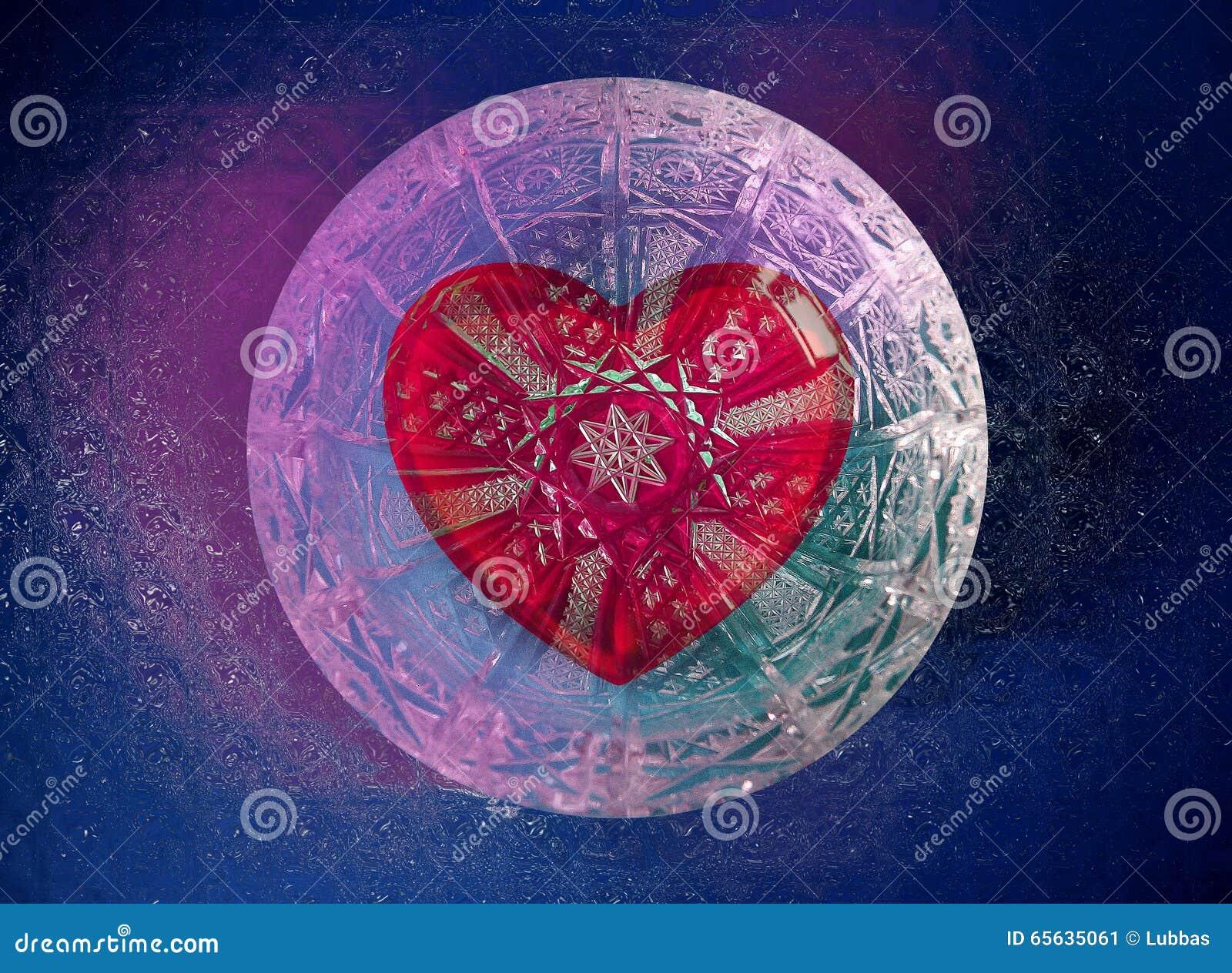 Coeur rouge de Valentine dans la boule de verre cristal