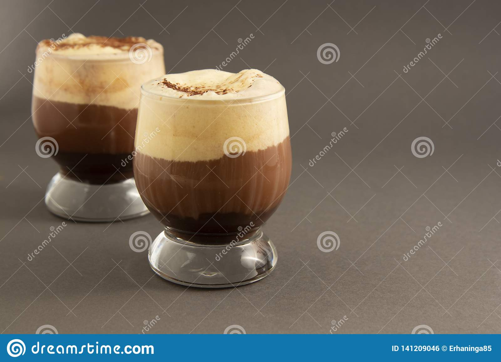Coffee affogato with vanilla ice cream and espresso. Glass with coffee drink and icecream. Copy space
