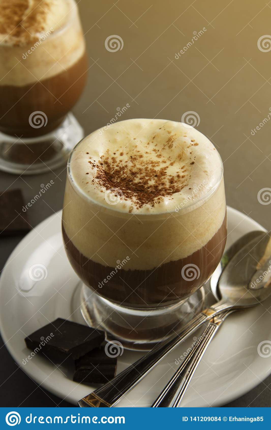 Coffee affogato with vanilla ice cream and espresso. Glass with coffee drink and icecream. Copy space