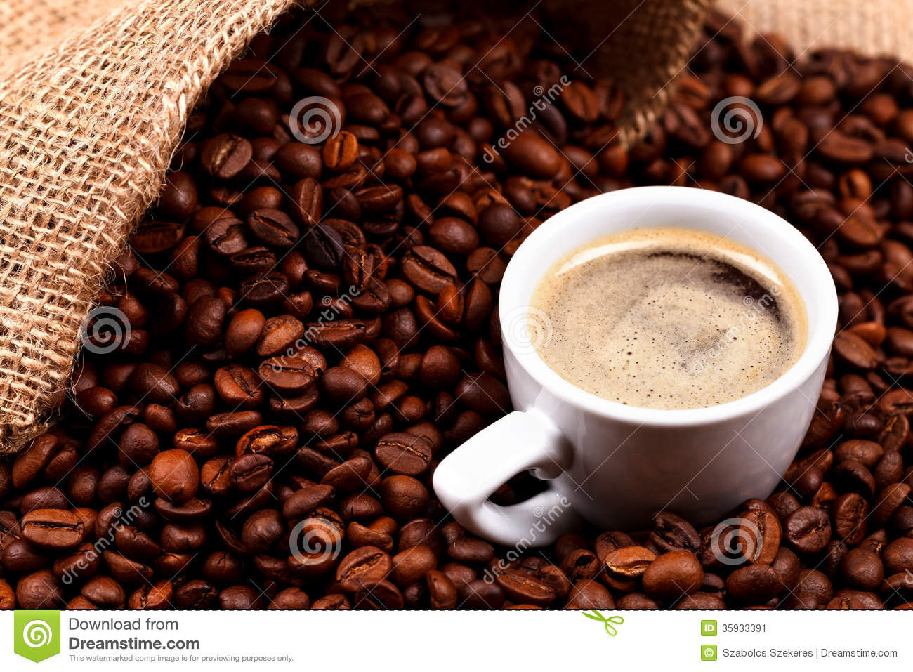 Coffee beans and a cup in burlap sack