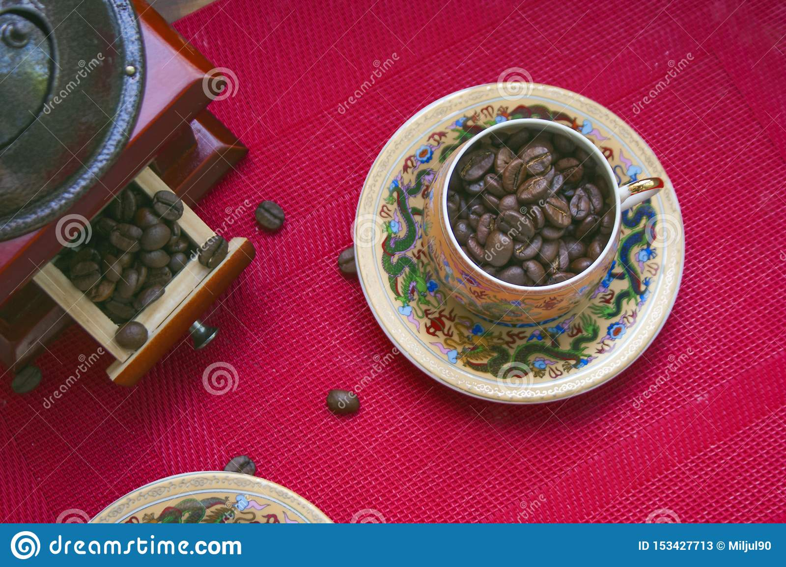 Coffee beans in a cup with a pattern