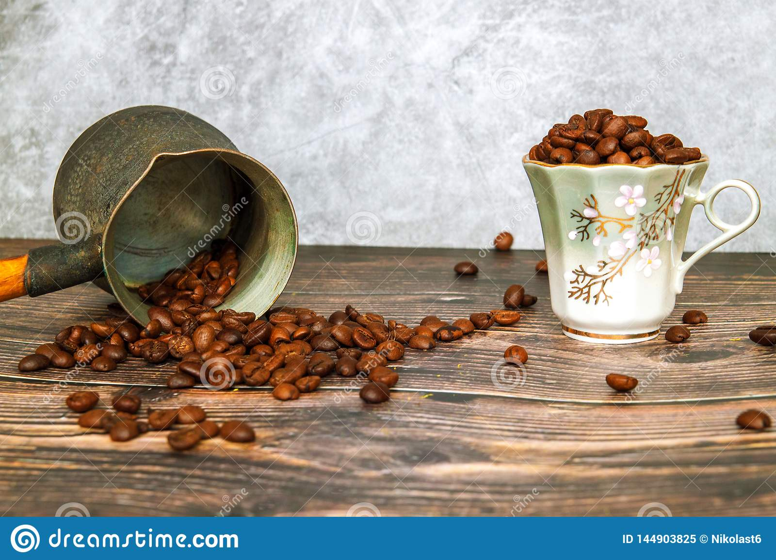 Coffee beans falling on wood table, vintage toned. How to choose a quality coffee.