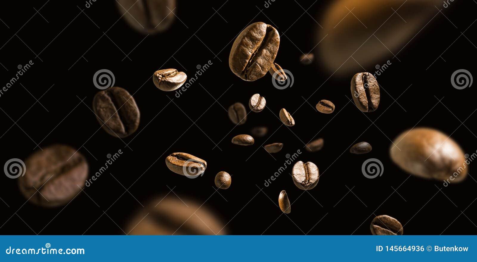 Coffee beans in flight on a dark background