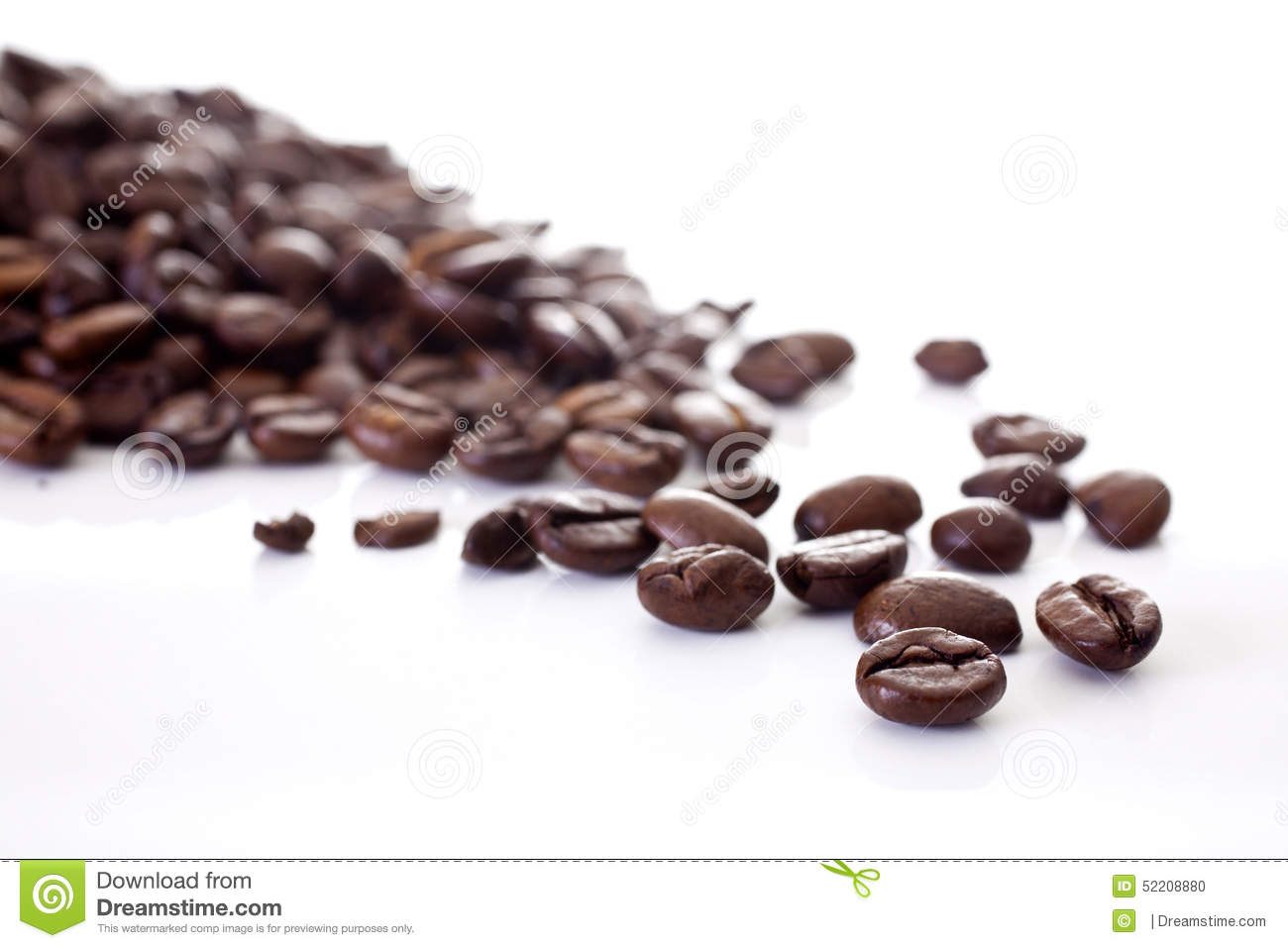 coffee beans scattered and isolated on a white background