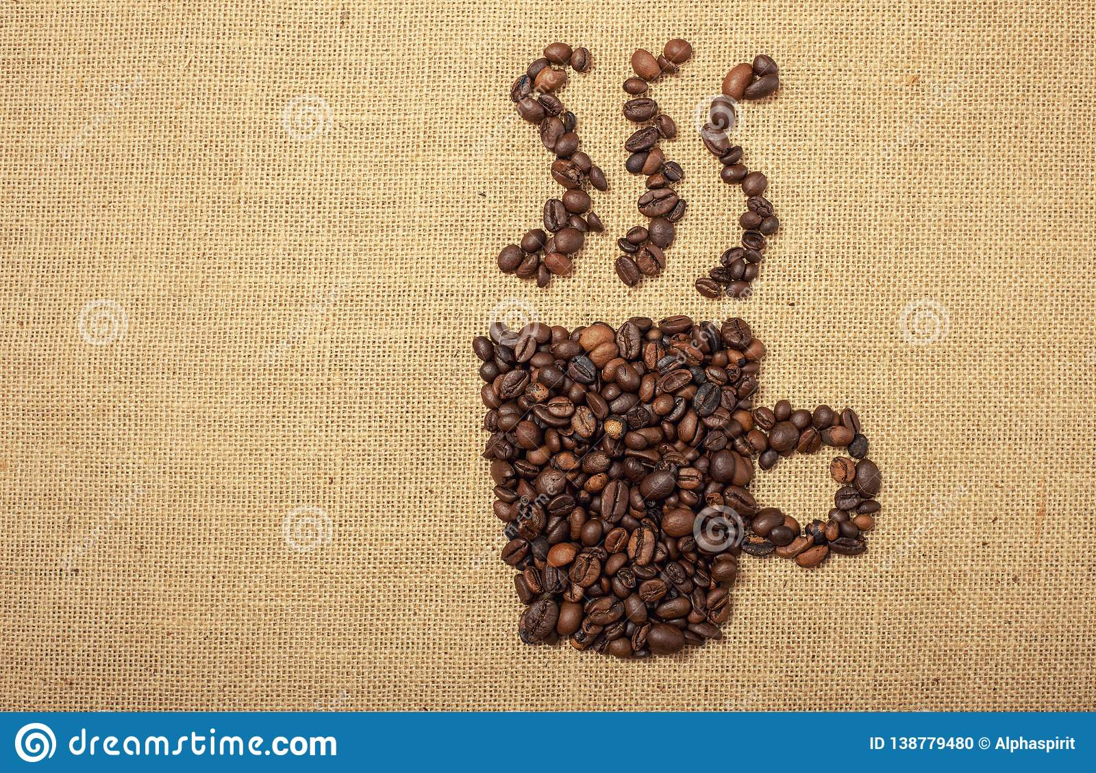 Coffee beans shaped as cup over a jute cloth