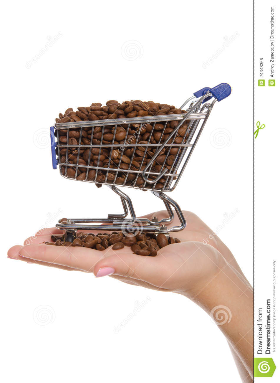 Coffee beans in shopping trolley on the palm