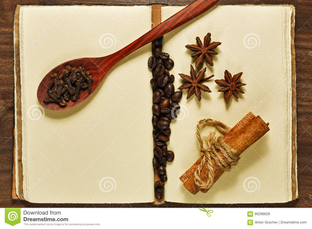 Coffee beans and spices on the vintage notebook