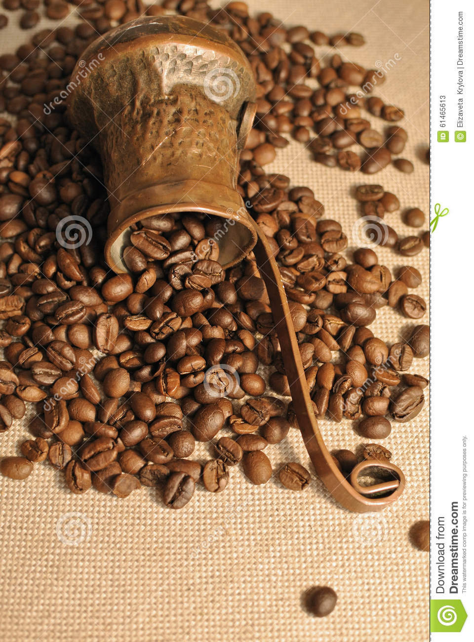 Coffee beans and vintage copper turkish coffee pot (cezve or ibrik) on the cloth sack