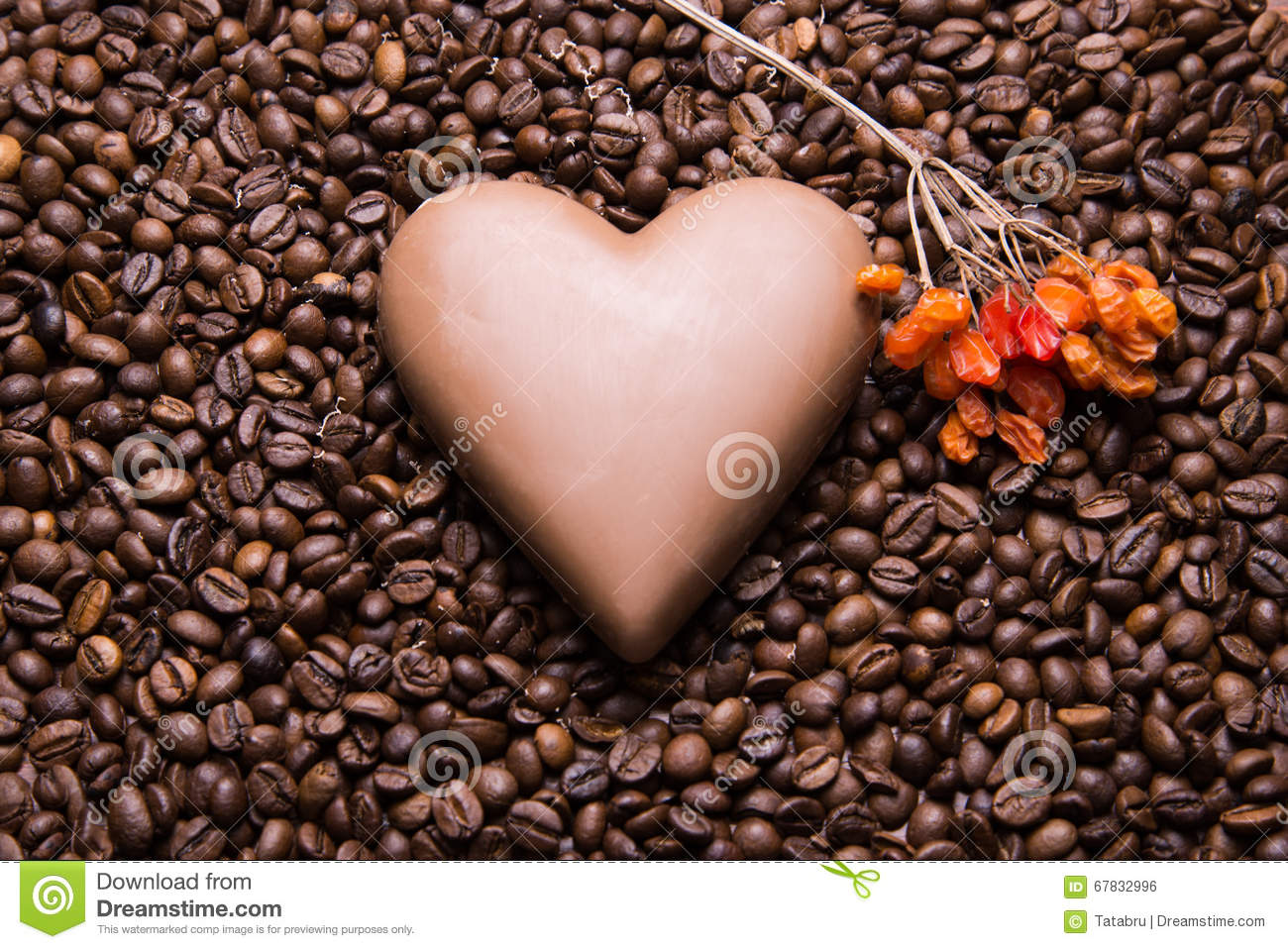 Coffee beans wallpaper with chocolate heart and viburnum berrie