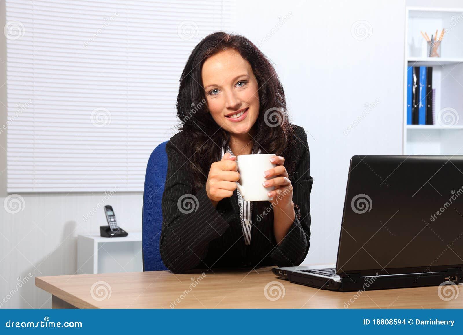 Coffee Break For Beautiful Woman At Office Desk Stock
