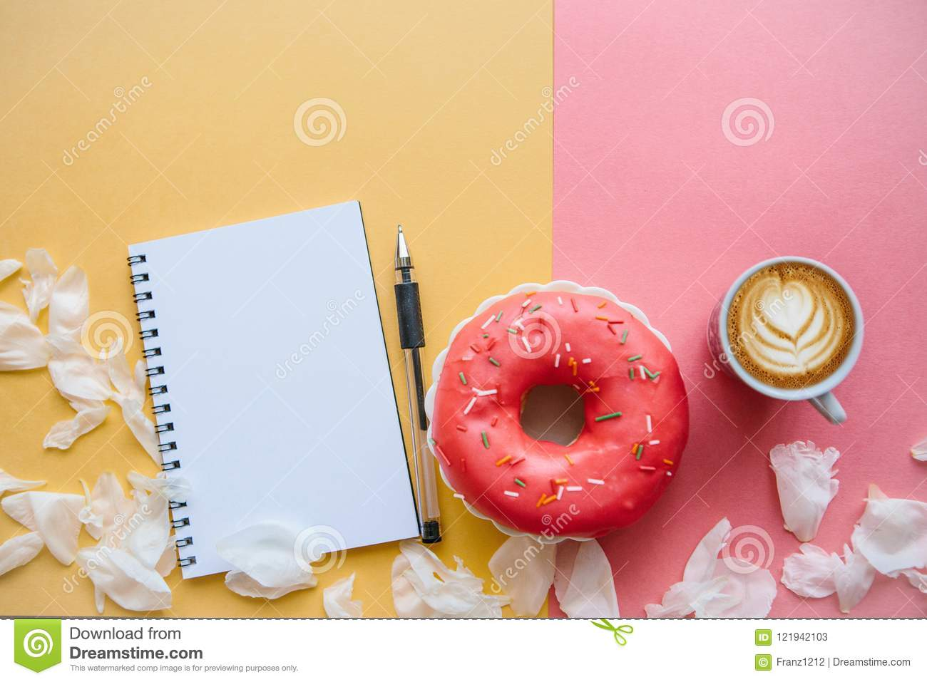 Coffee cappuccino and donut on a colored surface close up of a coffee cappuccino and donut on a colored surface close up of a white flower mightylinksfo