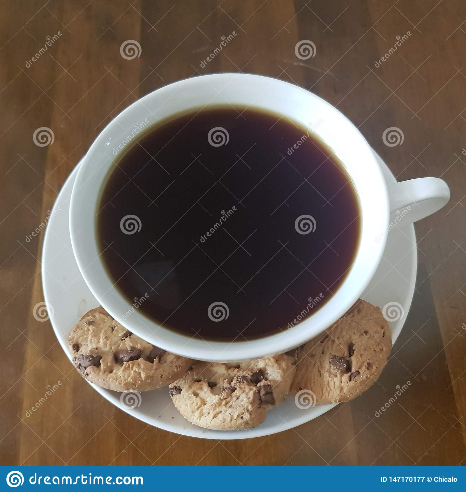 Black coffee and chocolate chip cookies quality time