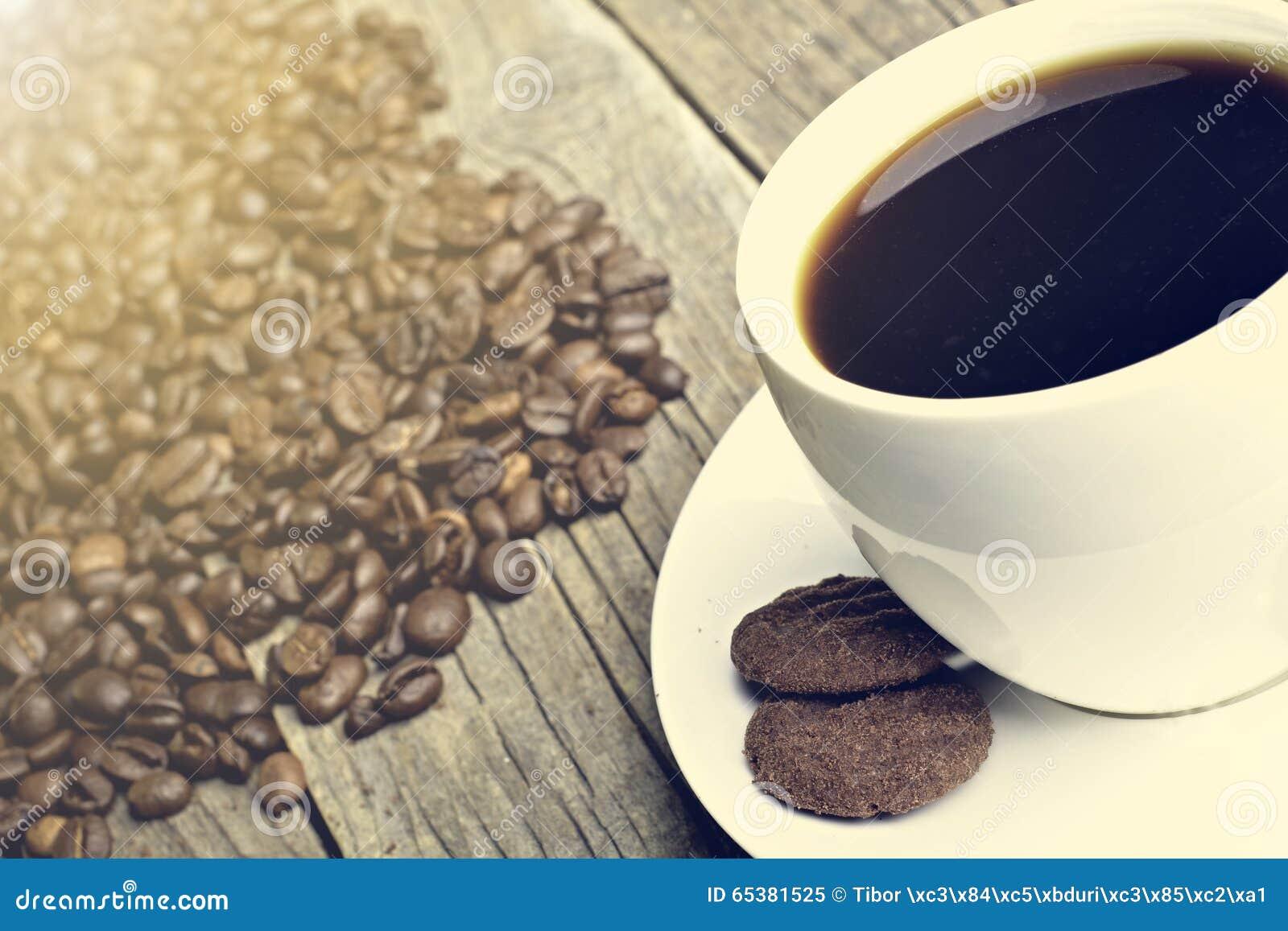 Natural Dark Coffee : Black and white coffee seed stock photo cartoondealer