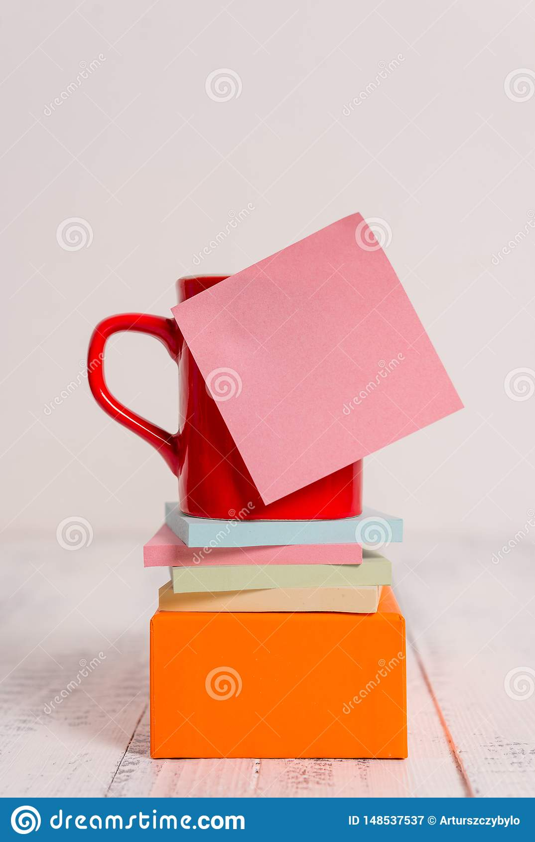 Front view coffee cup blank colored sticky note stacked note pads square box lying retro vintage rustic old table