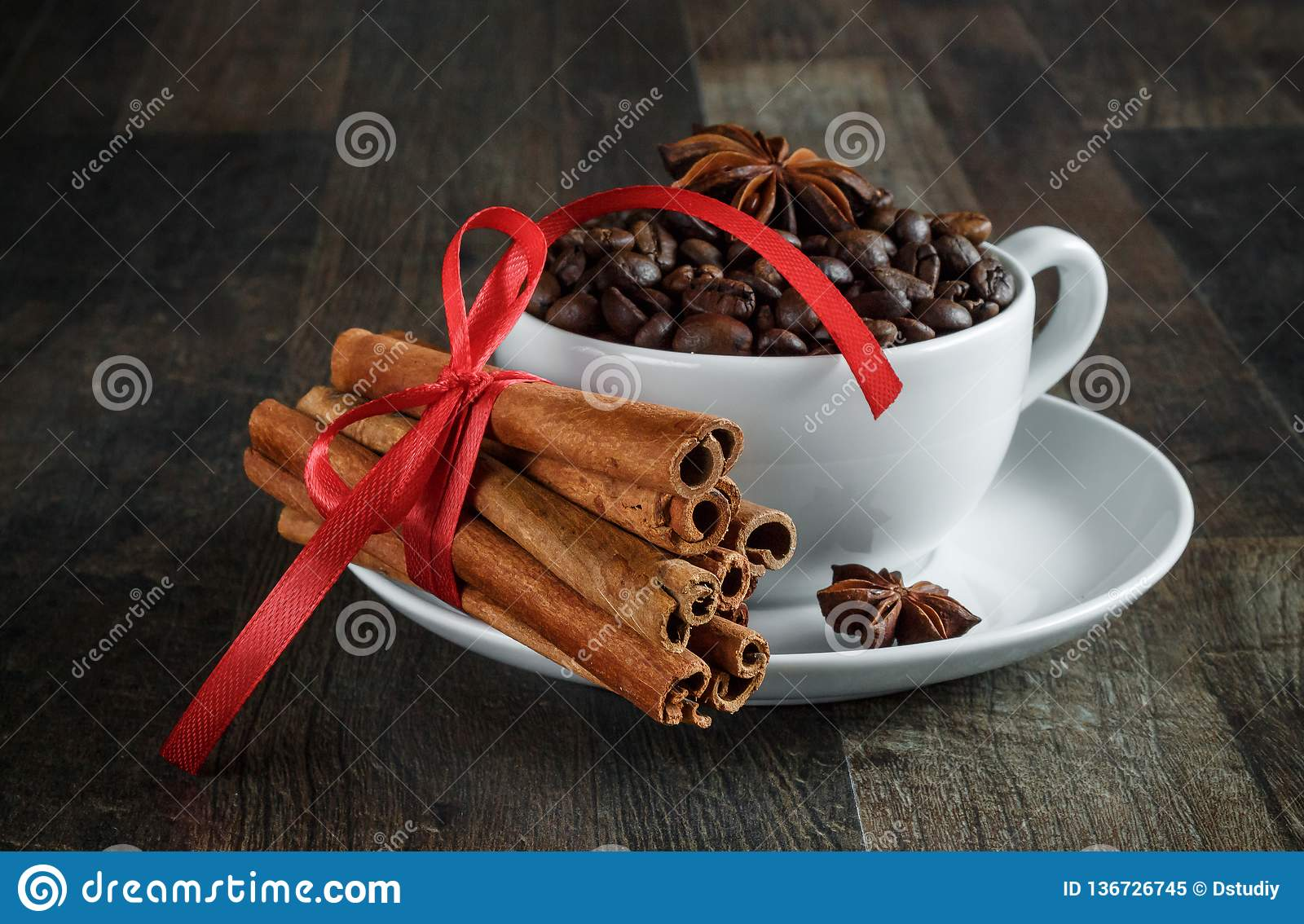 Coffee cup, coffee beans, spices, anise, cinnamon