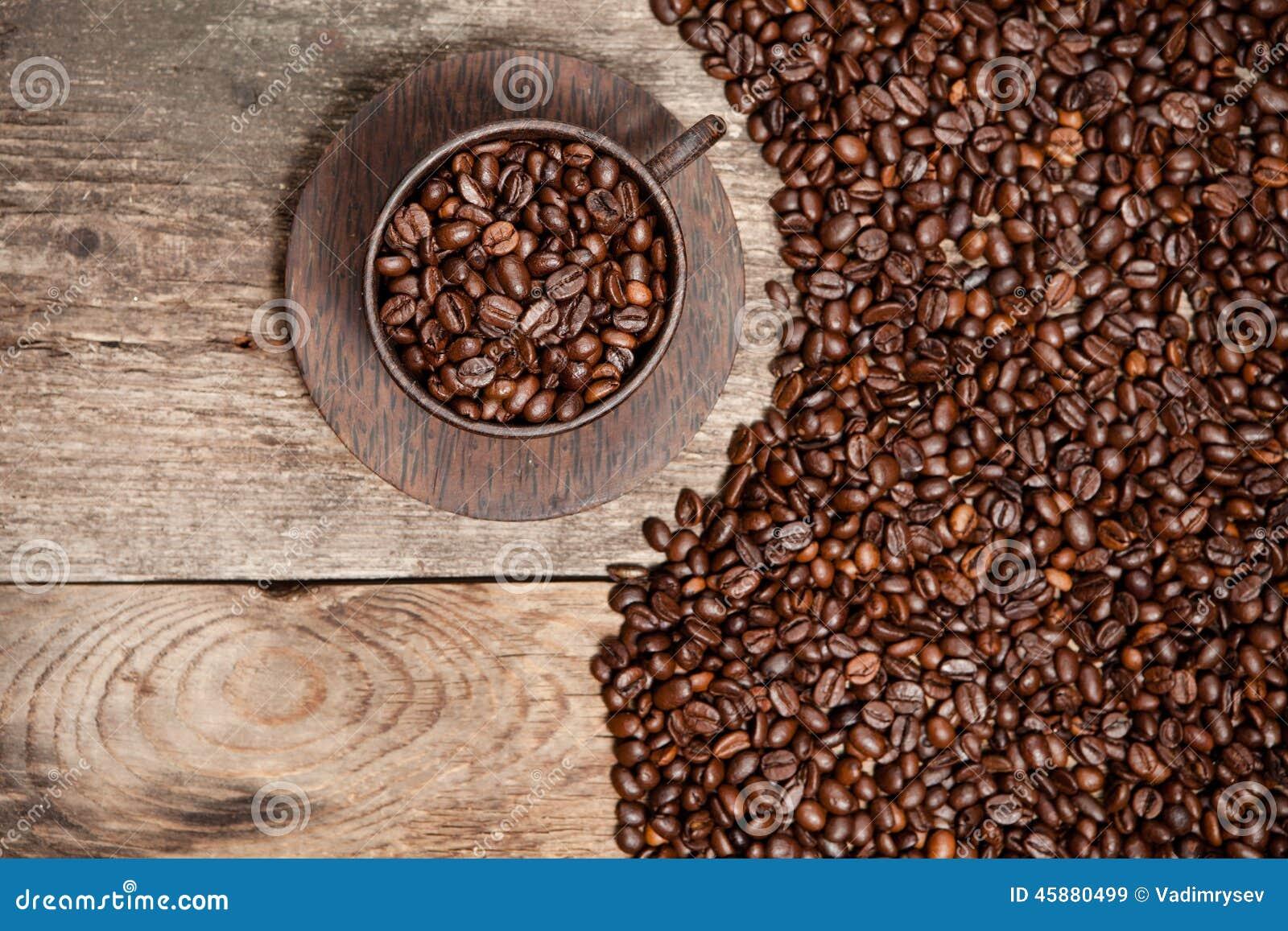 Astounding Coffee Cup With Coffee Beans On Wooden Table Stock Image Inzonedesignstudio Interior Chair Design Inzonedesignstudiocom