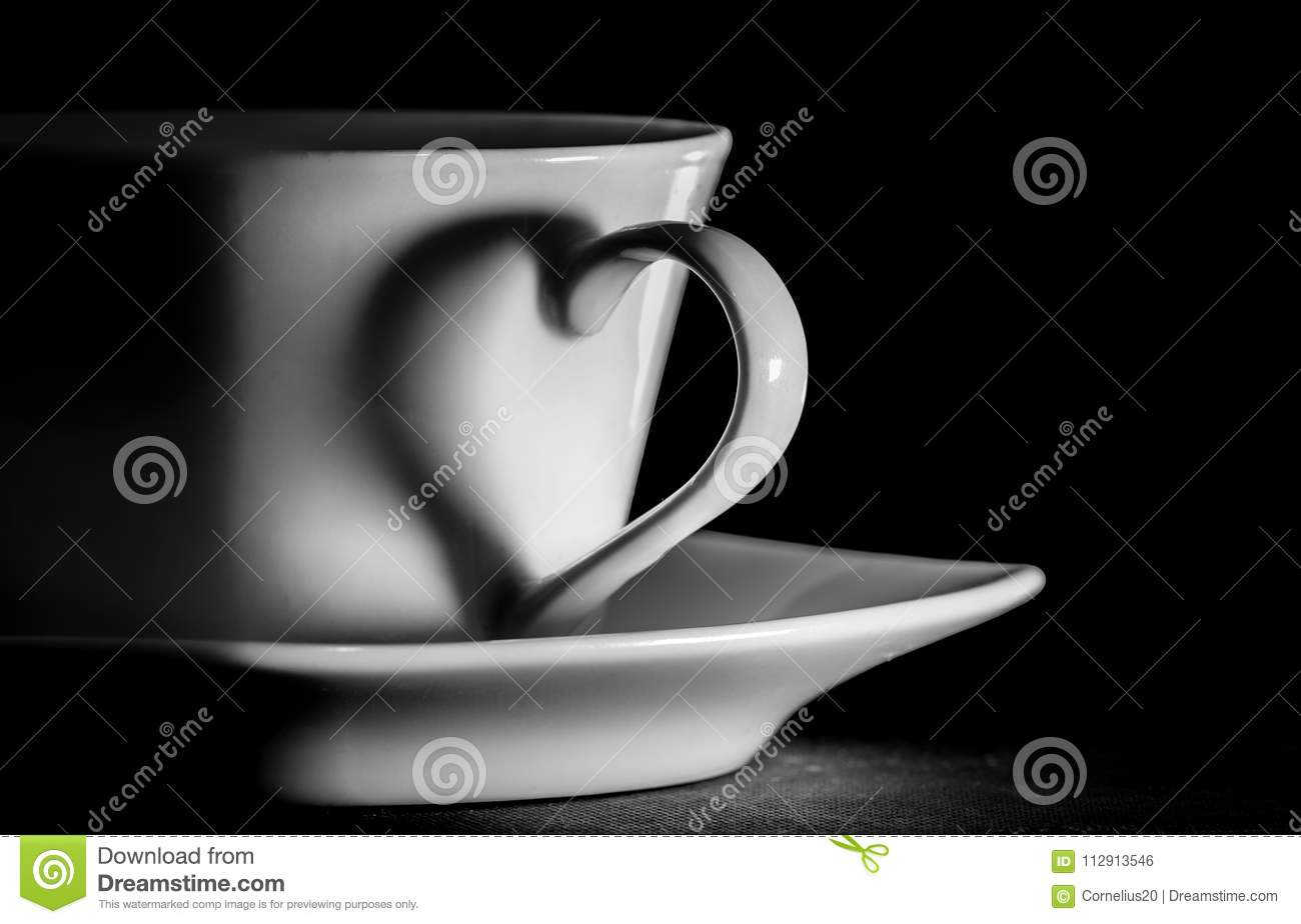 Coffee cup; the handle of the cup silhouettes a heart