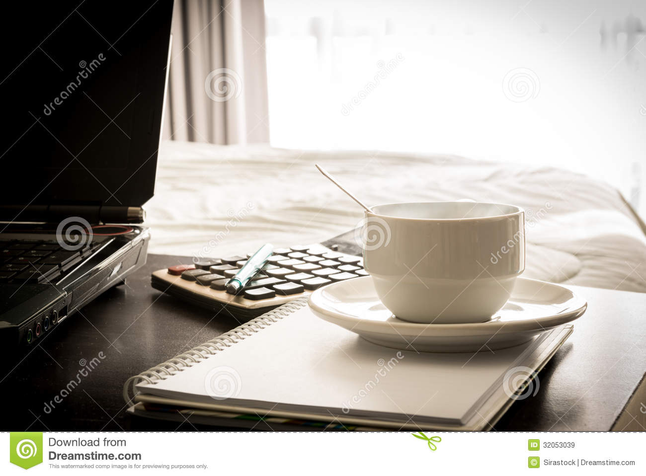 coffee cup with laptop and notebook and calculator stock