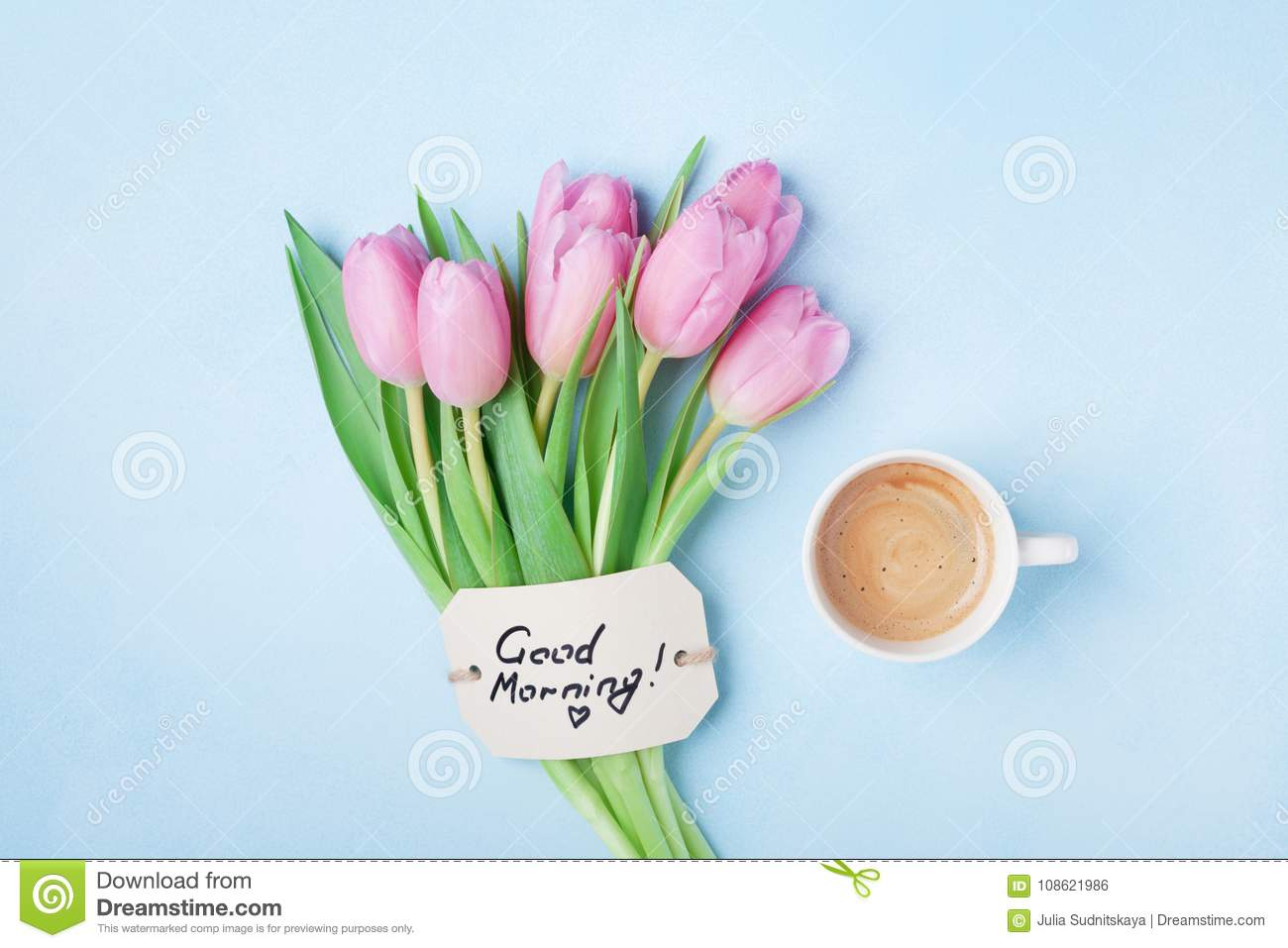 Coffee cup pink tulip flowers and note good morning on blue table download coffee cup pink tulip flowers and note good morning on blue table top view izmirmasajfo