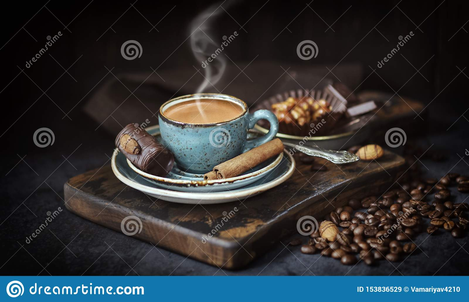 Coffee Cup on rustic background. Espresso with cinnamon sticks , blue Cup of coffee and coffee beans on an old Board, rustic, dark