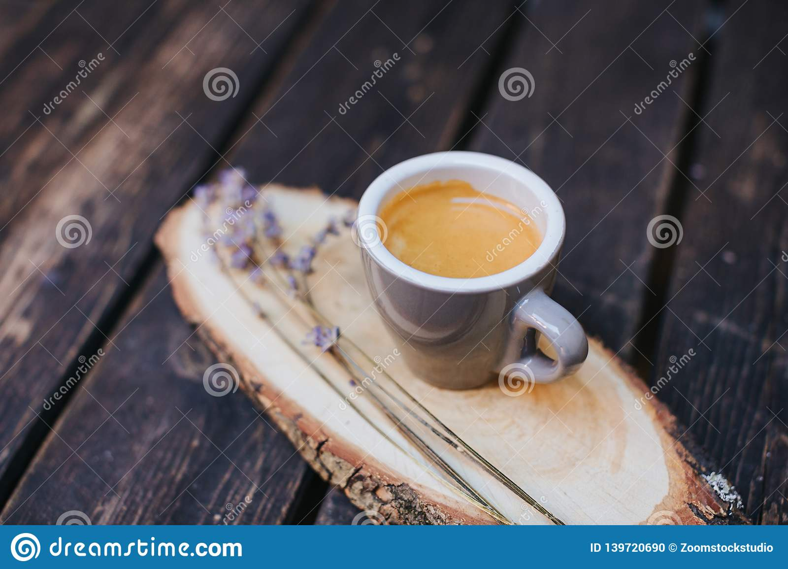 Coffee cup on table. Cup of hot latte coffee in the relaxing time. cup of coffee on wooden. Lavender. Aroma of lavender. Aroma of