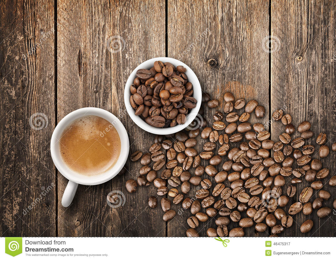 Coffee Cups Full Of Fresh Espresso And Beans On Wooden Table