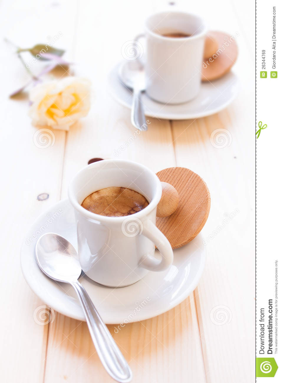 Espresso coffee cup on wood table for a energetic breakfast.