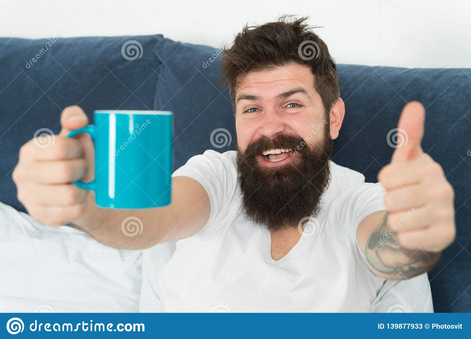 Coffee fills you with energy. Good gay begins from cup of coffee. Coffee affects body. Man handsome hipster relaxing on
