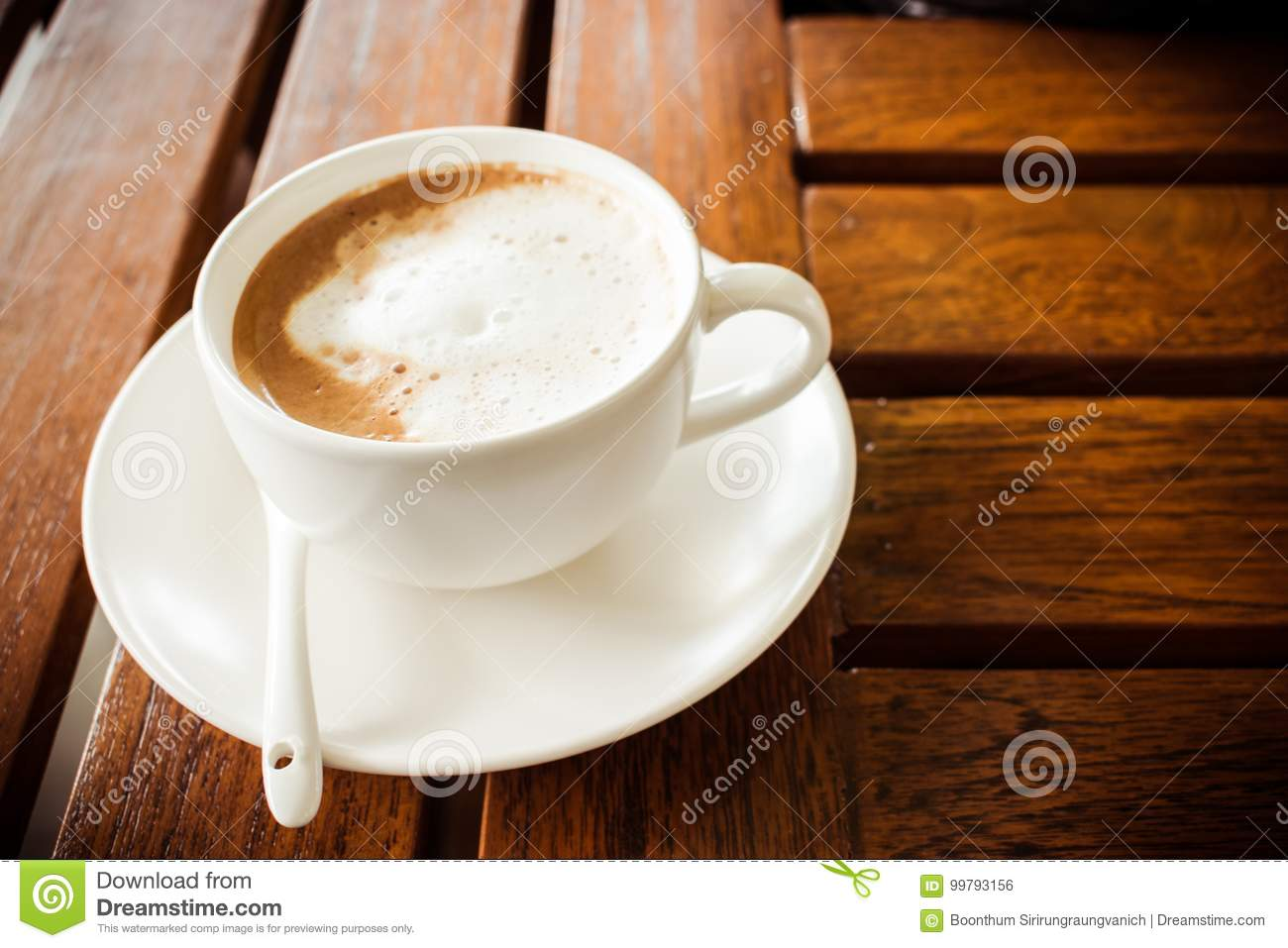 Coffee and glass on a wooden table