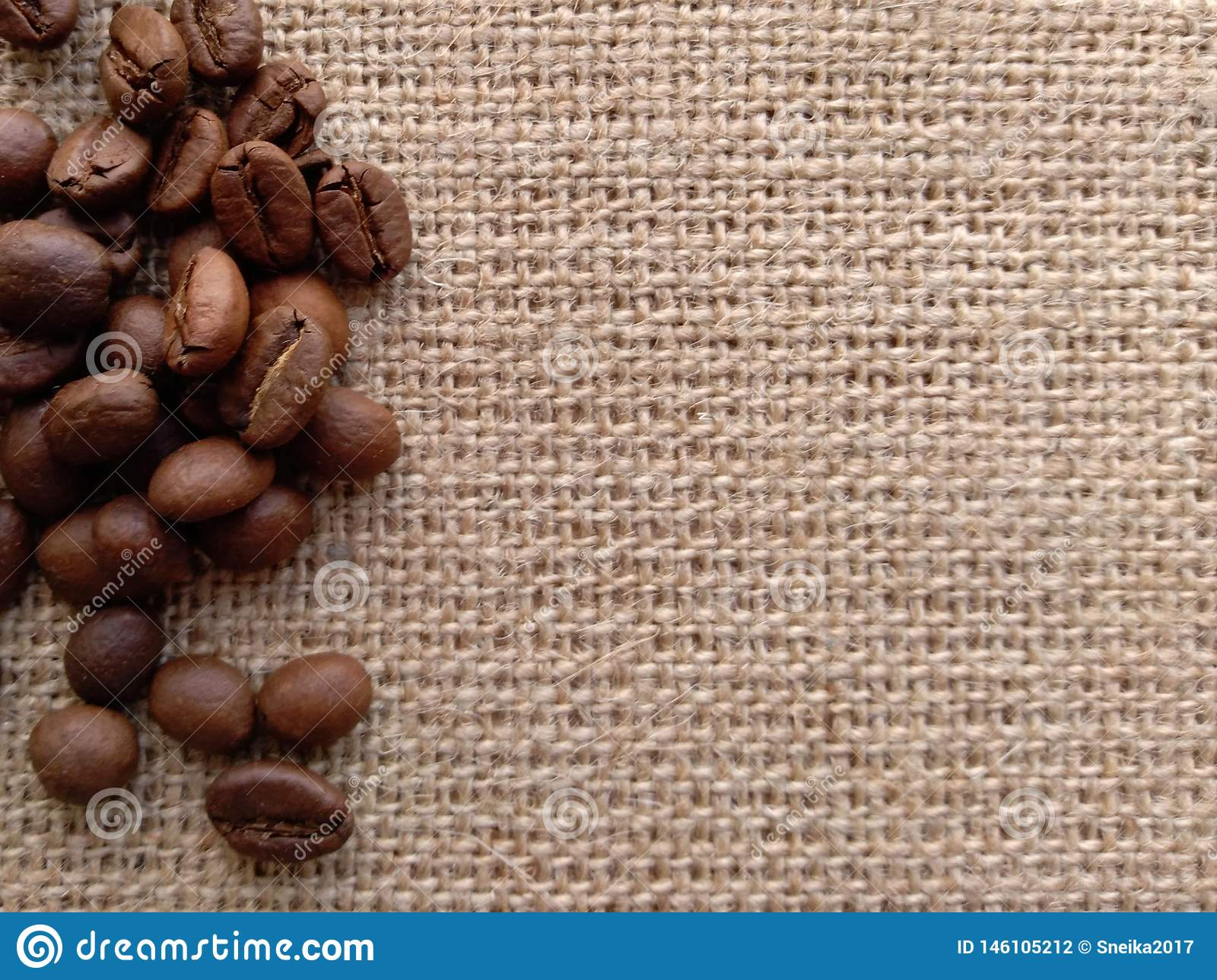 Coffee grains on byurlap. Available surface.
