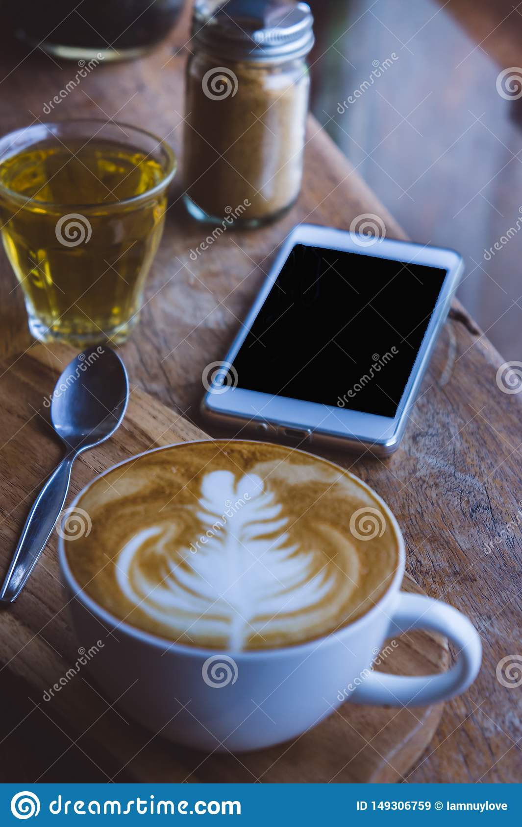 Coffee hot drink cappucino latte art on wood vintage table , coffee time on wood background cafe
