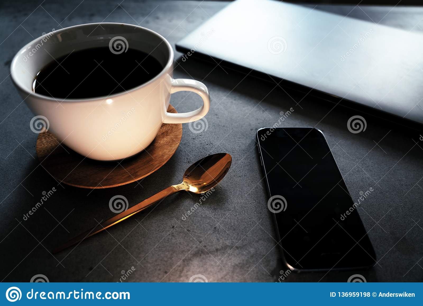 Coffee with laptop and smart phone on concrete table