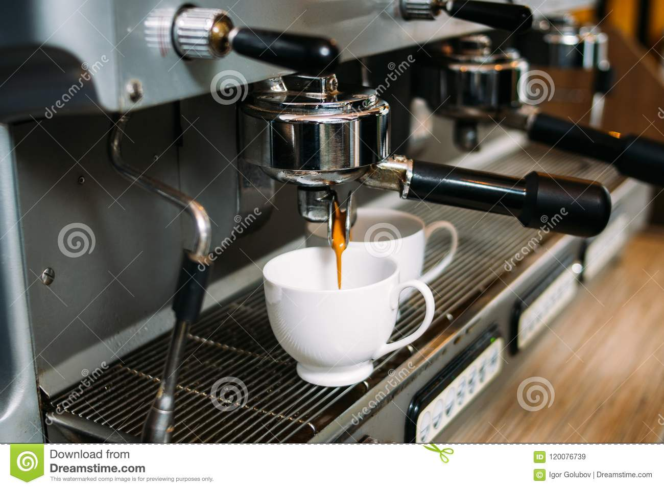 f8673240caf Drink pouring from coffee making machine into two white cups. morning  caffeine intake ritual. tasty hot dose of energy