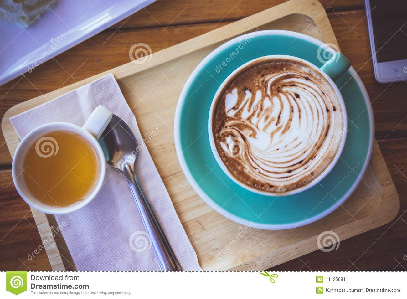 coffee mocha lattee cup on wood table and cake relax time on cafe shop