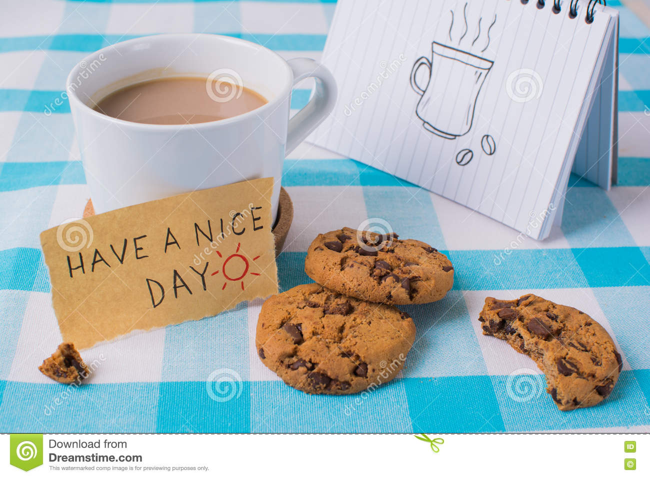 Coffee mug with notebook and message, have a nice day concept