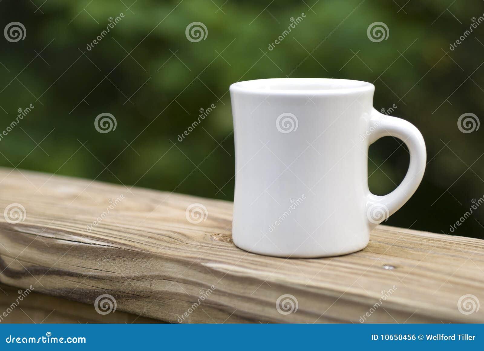 021ad4cf7c6 Coffee Mug on Railing stock photo. Image of wood, ceramic - 10650456