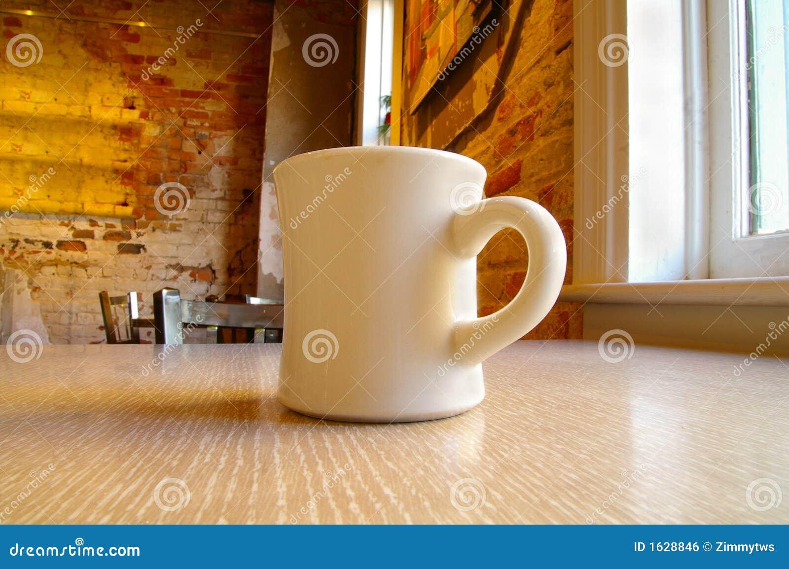 Coffee Mug And Table Royalty Free Stock Image - Image: 1628846