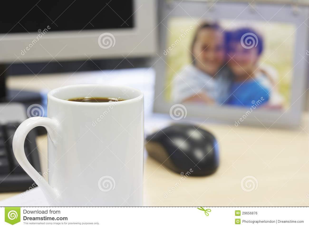 Coffee Mug On Table With Family Photo Royalty Free Stock