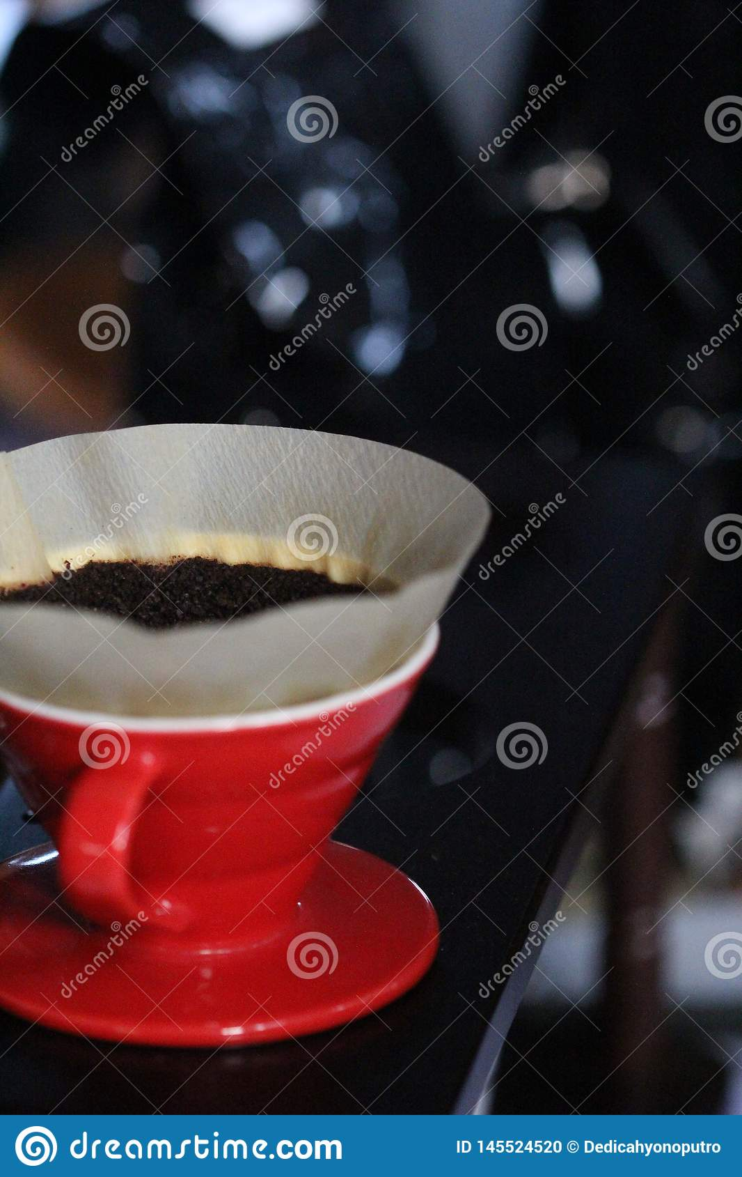 Coffee powder that will be brewed with a red cup