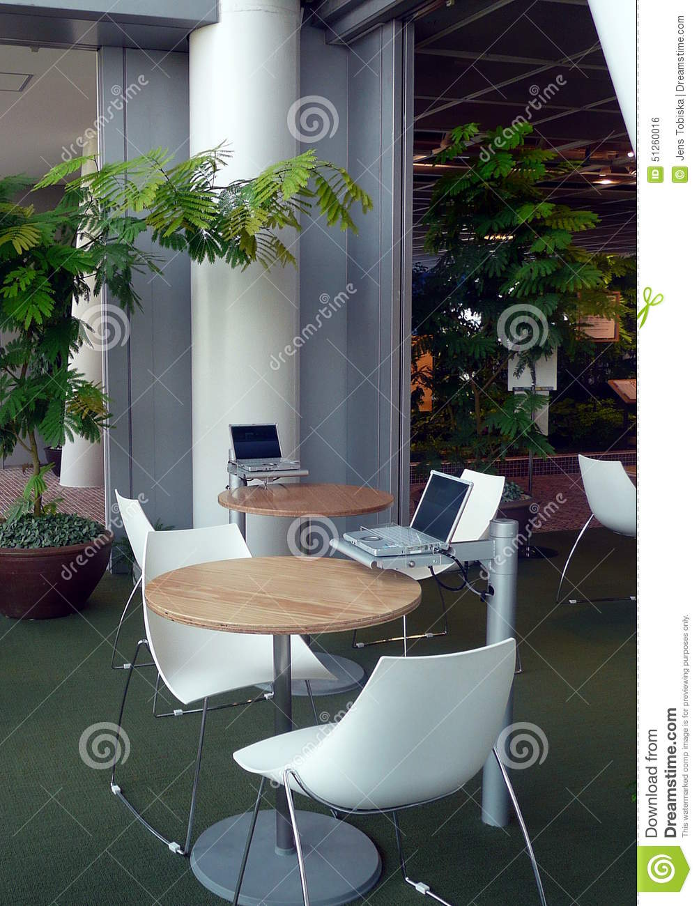 Classy Computer Tables To Go With Living Room Decor: Coffee Shop Computers Stock Photo