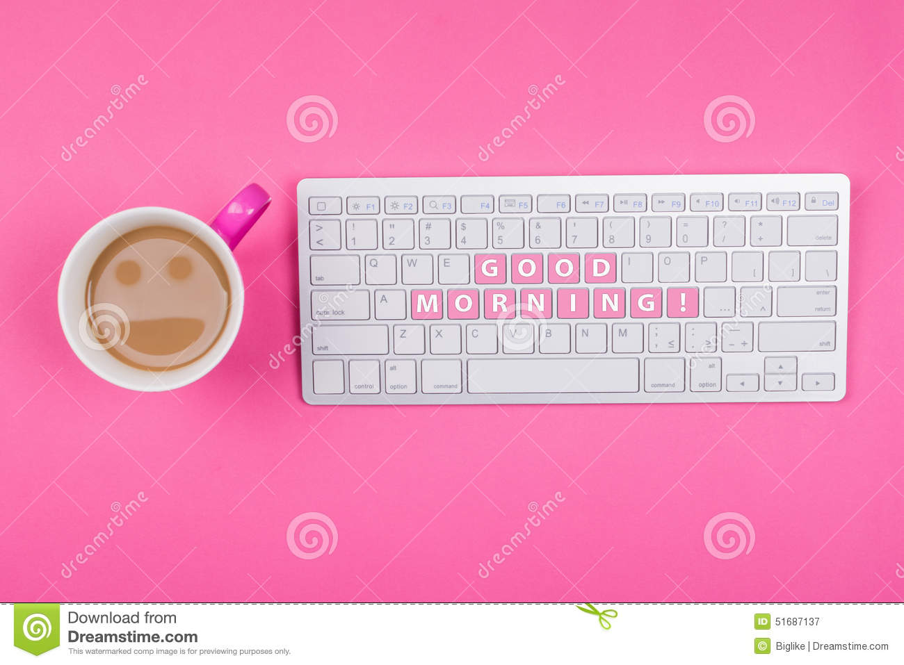 coffee with smiley face and good morning text on keyboard